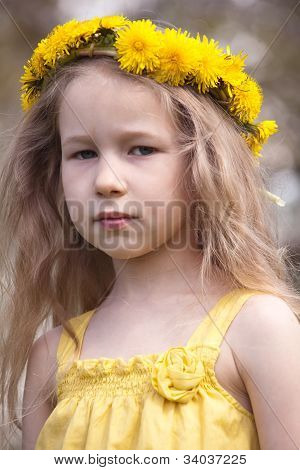 Portrait Of Little Girl In Dandelion Wreath