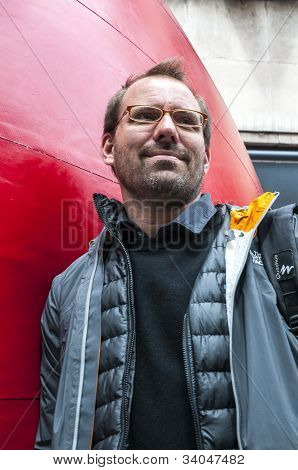 The artist Kurt Perschke standing by his giant Red Ball that was squeezed into the entrance of the
