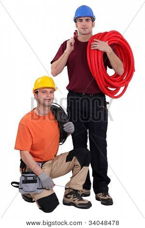 A team of construction workers with their tools and building materials