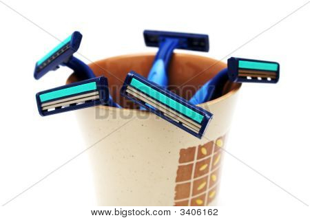 Blue Razors In Cup