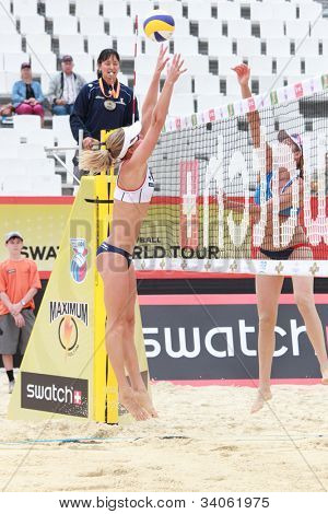 MOSCOW, RUSSIA - JUNE 8: Jennifer Kessy (right) and April Ross, USA vs Emilia and Erika (left) Nystrom, Finland, during Beach Volleyball Swatch World Tour in Moscow, Russia at June 8, 2012