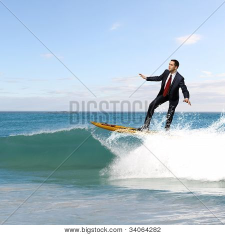 Young business person surfing on the waves