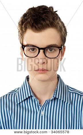 Closeup Of A Boy Wearing Glasses