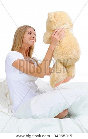 Young woman with teddybear