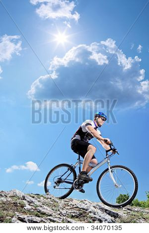 A view of a bicyclist riding a mountain bike downhill style