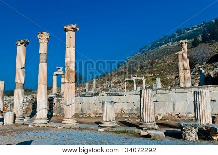 Ancient Roman Marble Column Of Ephesus Ruins With Deep Blue Sky In Background