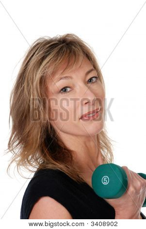Middle Aged Female Portrait With A Free Weight