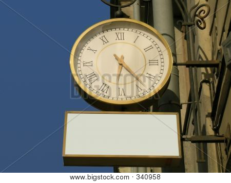 Street Clock With The Blank Advertisement Place
