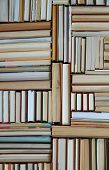 Many Books Piles. Hardback Books On Wooden Table. Books Stack Texture And Background. Back To School poster