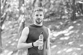 Refreshing Drink. Man Athletic Sportsman Hold Bottle Water. Athlete Drink Water After Training In Pa poster