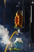 Hookah On The Orange. Orange Hookah. Hookah With A Round Transparent Flask In Which Sliced Oranges A poster