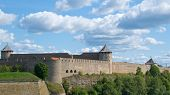 Old Medieval Fortress In Ivangorod, Russia, Located On The Right Bank Of The Narva River By The Esto poster