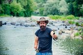 Portrait Of Cheerful Bearded Man Fishing. Fisher Fishing Equipment. Fishing Skills. Elegant Bearded  poster