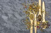 Assortment Of Different Grade Dry Tea In Wooden Spoons In Rustic Style. Organic Herbal, Green And Bl poster