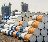 Industry oil chemical metal barrels stacked up in waste yard of tank and container, Kawasaki city ne poster