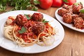 spaghetti with  meatballs in tomato sauce on a plate