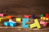 Simple Solutions To Complex Problems. Strategy In Business. Wooden Tetris Cubes On A Dark Background poster