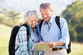 image of heterosexual couple  - Senior couple on country walk - JPG