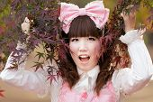 foto of lolita  - japanese girl in lolita cosplay fashion in park - JPG