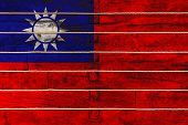 National Flag  Of Taiwan On A Wooden Wall Background. The Concept Of National Pride And A Symbol Of  poster