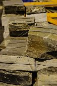 Stone Masonry Material On Construction Site. Industrial Cobblestones For Paving Terrace, Road Or Sid poster