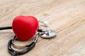 Red Heart With Medical Stethoscope. Placed On The Table With A Space To Put Text Heart Health Concep poster