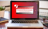 Ransomware Attack Concept. Ransomware Text On A Laptop Screen poster