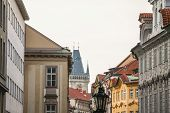 Old Town Hall Tower, A Clock Tower, In Prague, Czech Republic, Taken From The Narrow Streets Of Old  poster