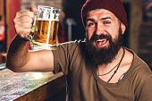 Alcohol Drinks. Hipster Brutal Man Drinking Beer At Bar Counter. Tattooed Hipster Male With Stylish  poster