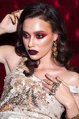 Glamour Fashion Photo Of A Beautiful Girl With Trendy Red Smokey, Blue Eyeliner, Dark Marsala Lipsti poster