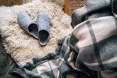 The Pair Of Gray Home Slippers Near The  Bed On The White Sheepskin In The Cozy Bedroom. Home Sweet  poster