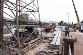 An Excavator Loader Machine, Pile Driving Machine And Concrete Piles On Pontoon Floating In River Fo poster