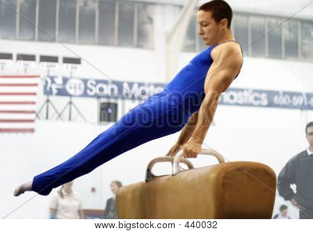 Young Man Competing On Pommel