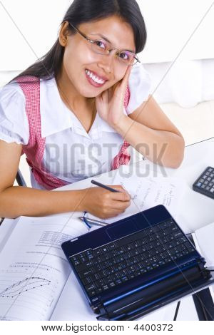 Female Scholar Looking At Camera While Studying