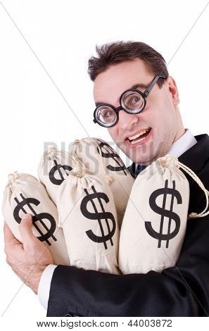 Businessman with sacks of money on white