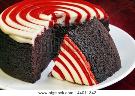Red velvet cake, with cut slice.