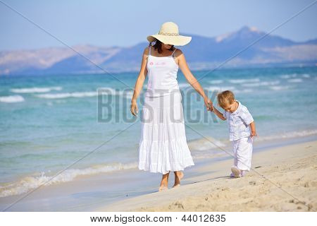mother and son having fun beach ...
