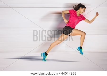 Sport Woman Starting Running. Speed Effect.