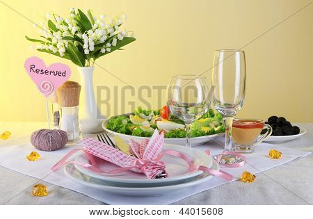 Table setting on yellow background