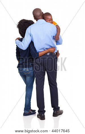 rear view of young african american couple carrying baby boy isolated on white