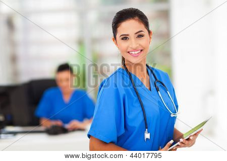 beautiful young medical worker holding tablet computer