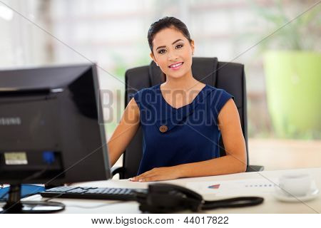 portrait of young indian manager in her modern office