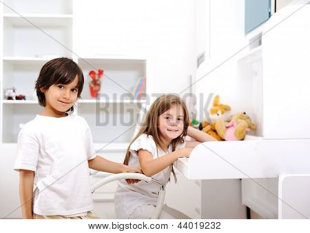 Adorable kids brother and sister at home in children room