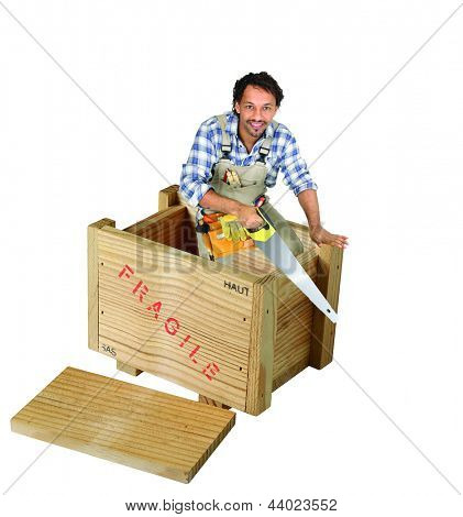 Carpenter with saw stood in wooden box