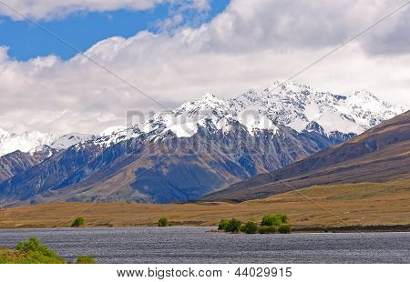 Snow Capped Mountains Above A Remote Lake