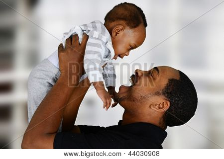Father and his son playing inside their home
