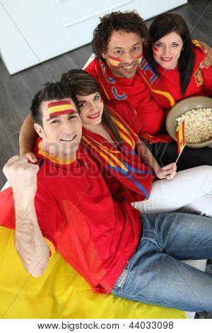 Four Spanish soccer fans waiting for the  match to start