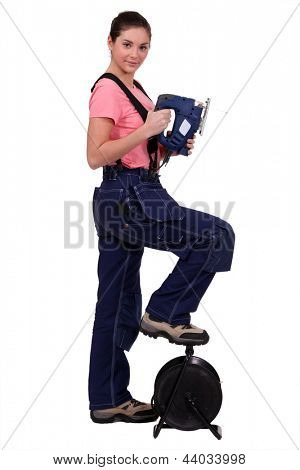 Handywoman with a sander