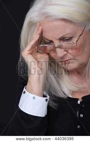 Old woman with headache