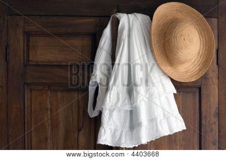 Clothes On Antique Wardrobe Closet
